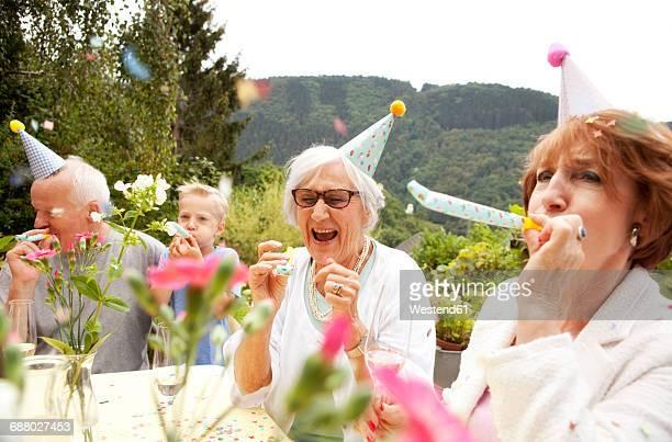 Seniors celebrating birthday oarty in garden