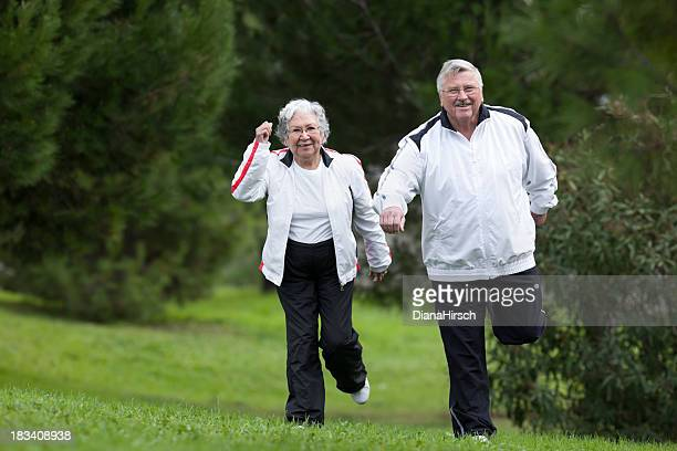 seniors couple jogging in the park