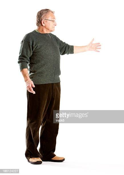 seniors: elderly man presenting copy space - presenter stock pictures, royalty-free photos & images