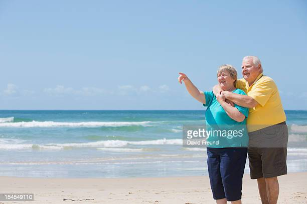 seniors enjoying beach view - fat guy on beach stock pictures, royalty-free photos & images