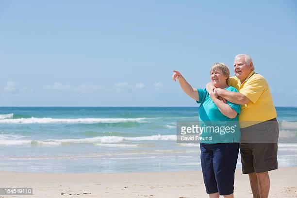 seniors enjoying beach view - fat man on beach stock photos and pictures