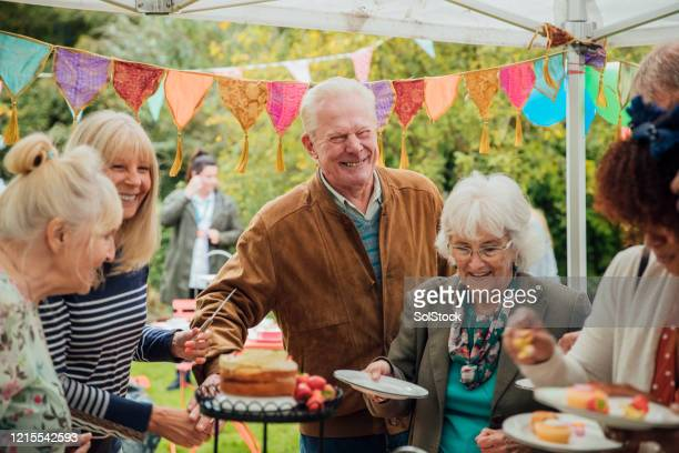 seniors enjoying cake - gala stock pictures, royalty-free photos & images