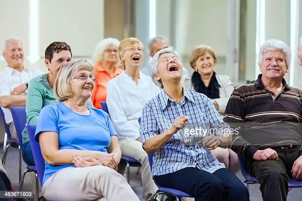 Seniors Enjoying Stage Performance