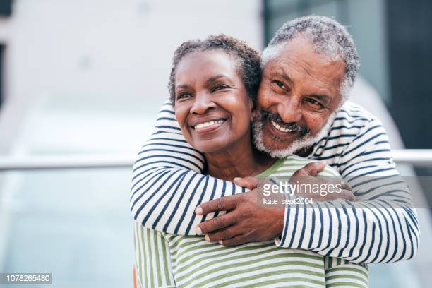 seniors . enjoying time together - black stock pictures, royalty-free photos & images