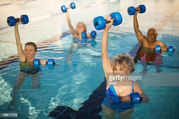 Seniors Exercising in Swimming Pool