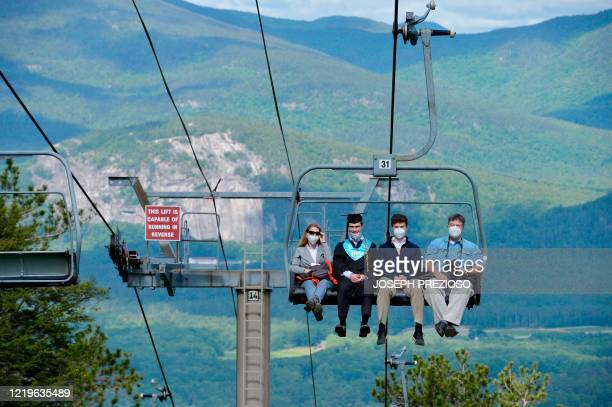 Seniors from Kenneth High School and family ride a ski lift to the summit of Cranmore Mountain in North Conway New Hampshire on June 13 for their...