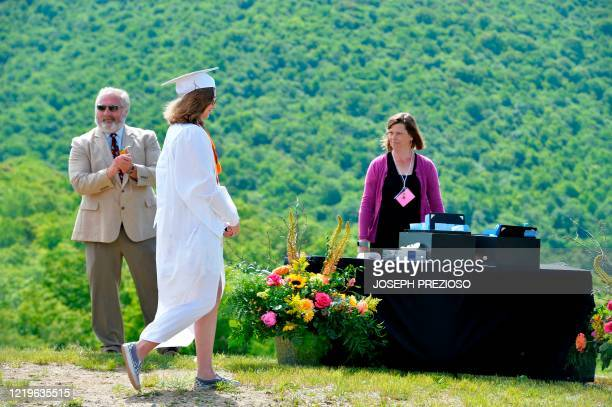 Seniors from Kenneth High School receive their diplomas on the summit of Cranmore Mountain in North Conway, New Hampshire, on June 13, 2020. - The...