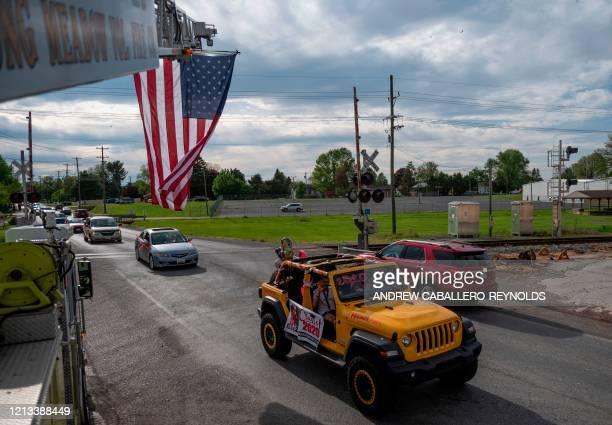 Seniors from North Hagerstown High School take part in a senior ride after their prom was cancelled due to the coronavirus COVID19 pandemic in...