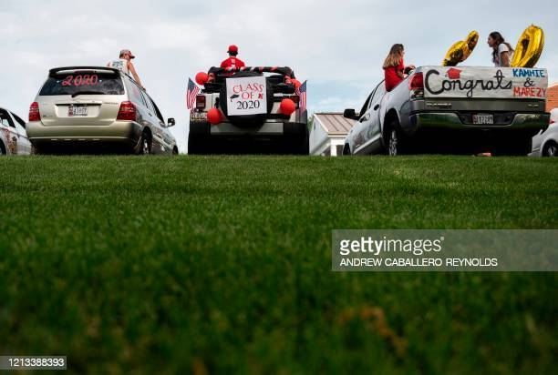 Seniors from North Hagerstown High School wait in their cars to take part in a senior ride after their prom was cancelled due to the coronavirus...