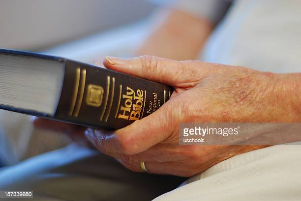 senior's hands on bible - old testament stock pictures, royalty-free photos & images