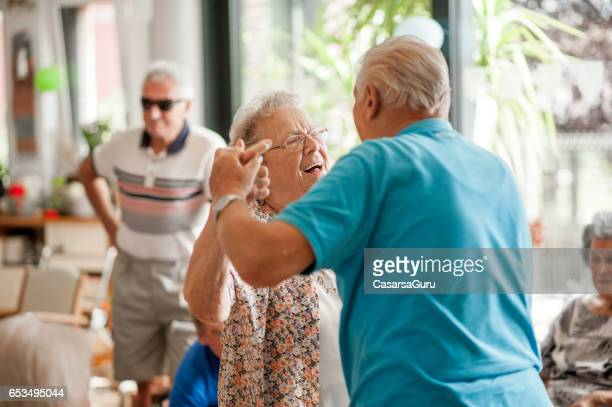 seniors having fun in the community center - community centre stock pictures, royalty-free photos & images