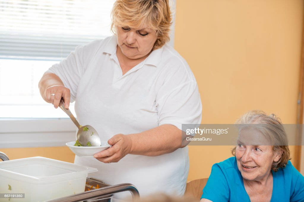 Seniors Having Lunch In The Dining Room Of The Retirement Center : Stock Photo