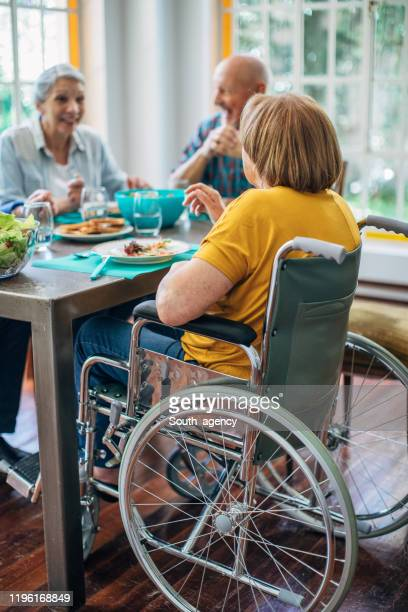 seniors having meal in their retirement home - retirement community stock pictures, royalty-free photos & images
