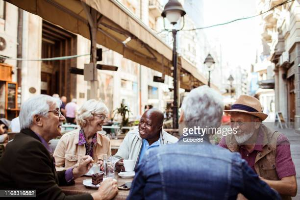seniors in a cafe - small group of people stock pictures, royalty-free photos & images