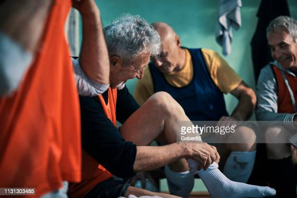 seniors in a dressing room - locker room stock pictures, royalty-free photos & images
