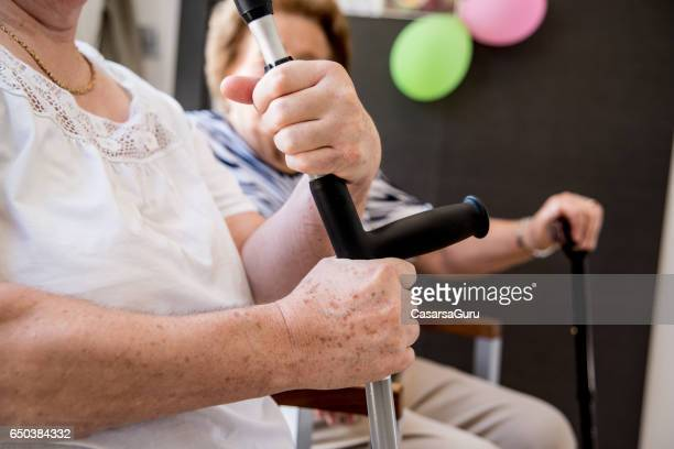 Seniors  In The Elderly Day Care Center Need Help For Walking