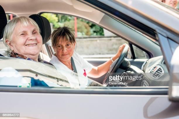 Seniors In the Nursing Home Enjoying  A Car Ride