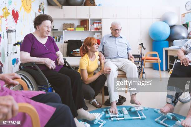 Seniors In The Nursing Home Having Reflexotherapy