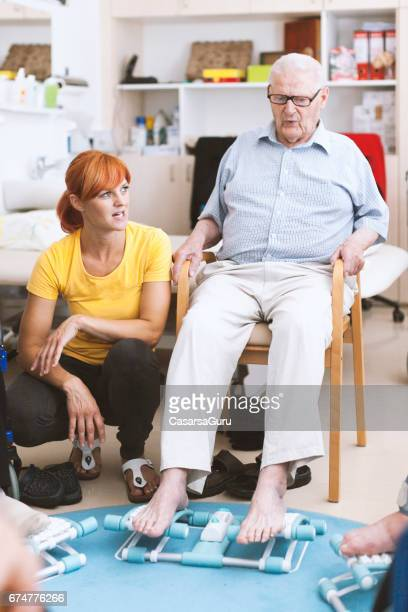 seniors in the nursing home having reflexotherapy - blood flow stock pictures, royalty-free photos & images