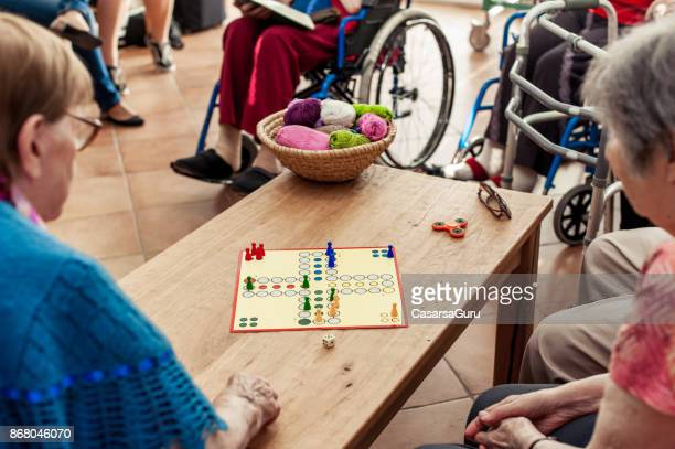 Seniors In The Nursing Home Playing Games For Leisure