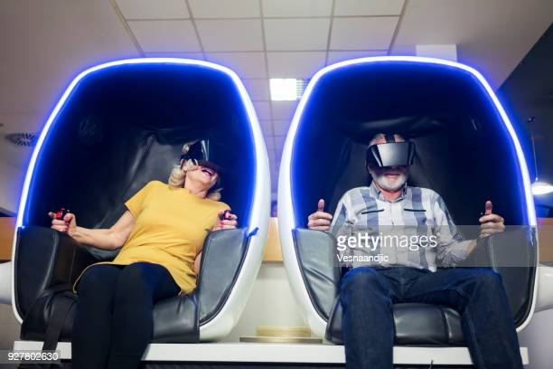 senior's in virtual reality simulator - arts culture and entertainment stock pictures, royalty-free photos & images