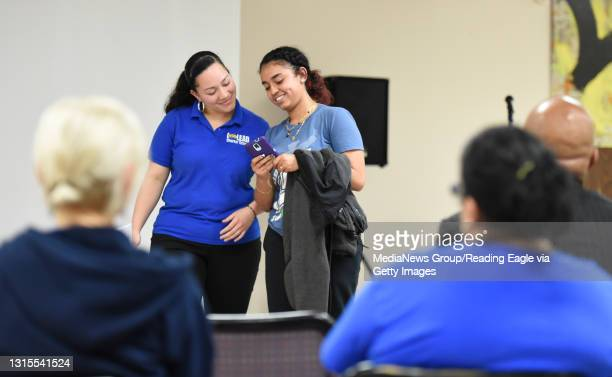 Seniors Kimberly Escobar, left, and Deanna Resto act out a skit during a portion of the presentation.Happiness Project of Reading teams with I-Lead...