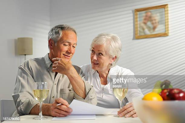 seniors looking at paperwork - 60 69 years stock photos and pictures