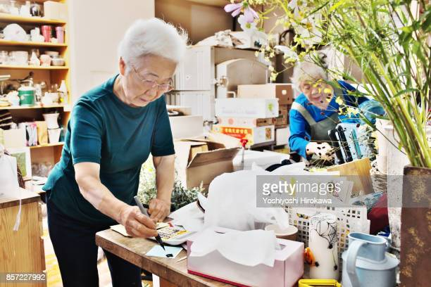 seniors of small flower shop - working seniors stock pictures, royalty-free photos & images