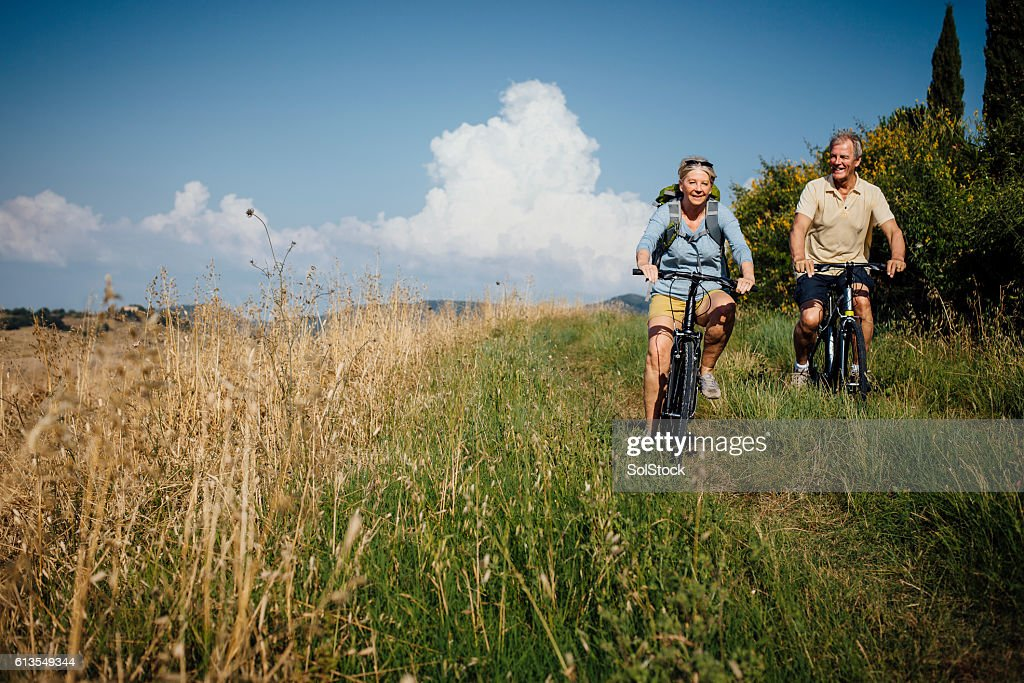 Seniors on Mountain Bikes in the Countryside : Stock Photo