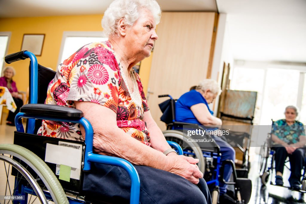 Seniors On The Wheelchair Attend In The Retirement Home : Stock Photo