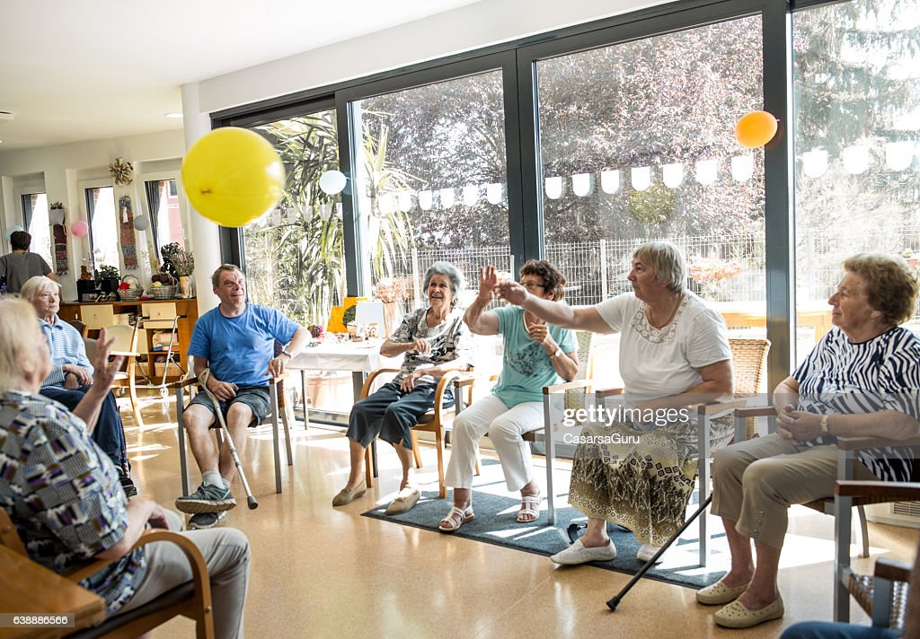 Seniors participating in Group Activities in Adult Daycare Center : Stock Photo