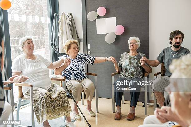 Seniors participating in Group Activities in Adult Daycare Center