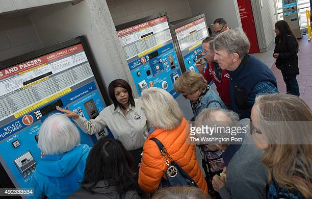 Seniors pay attention to Jeanna Muhoro Fairfax County Neighborhood and Community Services demonstrate how to purchase and add fare to their new...