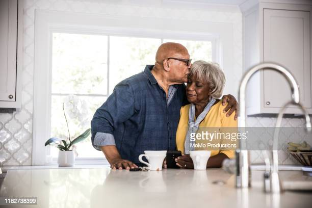 seniors - kissing stock pictures, royalty-free photos & images
