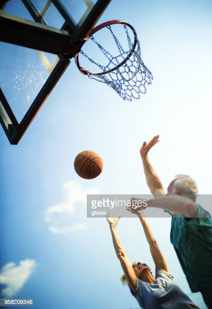 seniors playing basketball. - dribbling sports stock pictures, royalty-free photos & images
