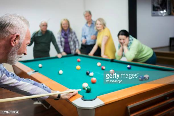 senior's playing billiard - old men playing pool stock pictures, royalty-free photos & images