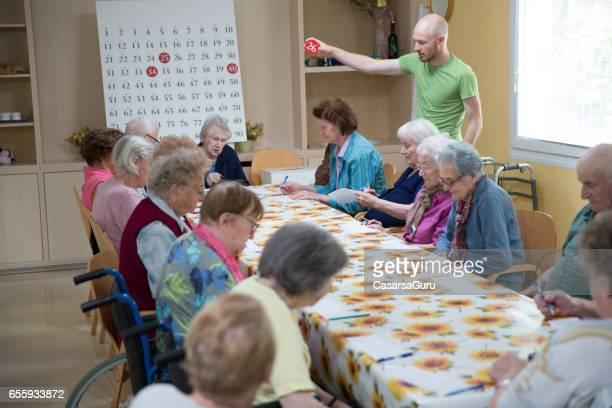 Seniors Playing Bingo In The Retirement Community