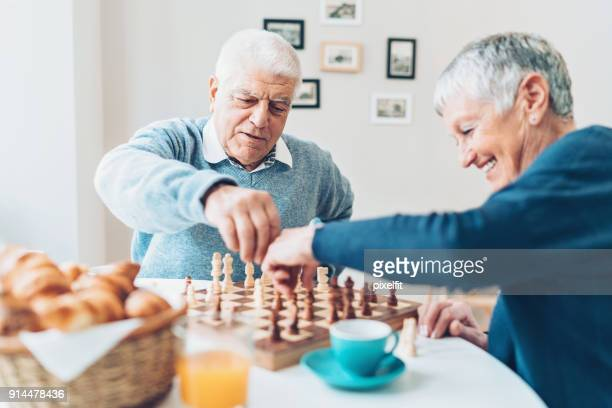 seniors playing chess - chess stock pictures, royalty-free photos & images
