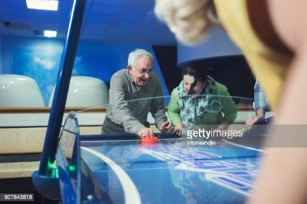 Senior's playing table hockey
