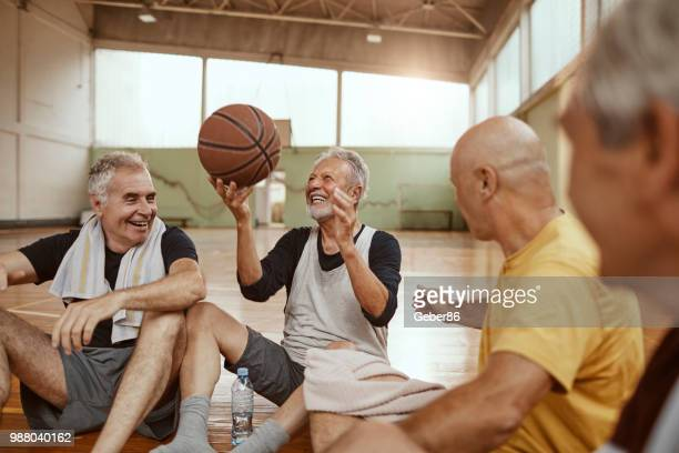 seniors relaxing - basketball sport stock pictures, royalty-free photos & images