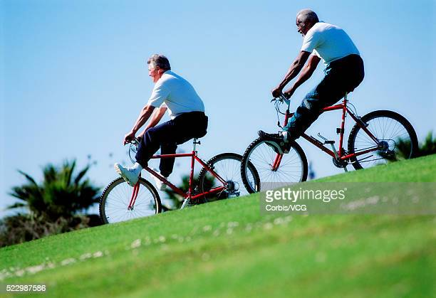 Seniors Riding Bikes Downhill
