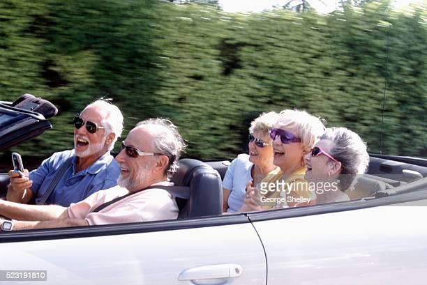 Seniors Riding in Convertible