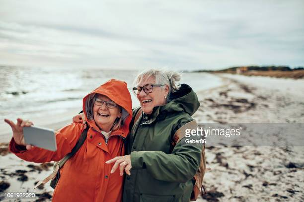 seniors selfie - photo messaging stock pictures, royalty-free photos & images