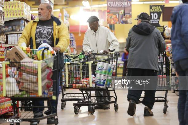 Seniors shop for groceries during special hours open to seniors and the disabled only at Northgate Gonzalez Market a Hispanic specialty supermarket...