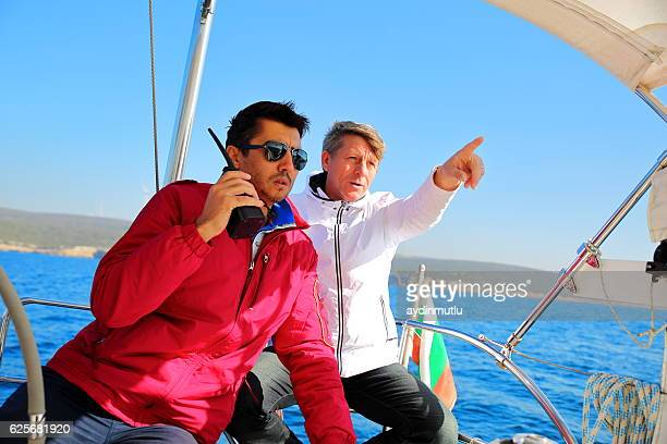 seniors skipper sailing with sailboat - sailing team stock pictures, royalty-free photos & images