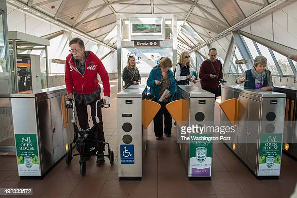 Seniors swipe their Senior SmarTrip cards to exit the WiehleReston East Metro station during a handson learning session on the bus and Metrorail on...