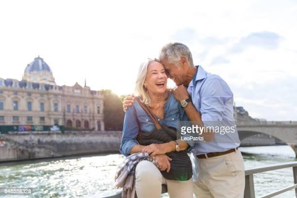 Seniors taking a break in Paris relaxing on the Seine River
