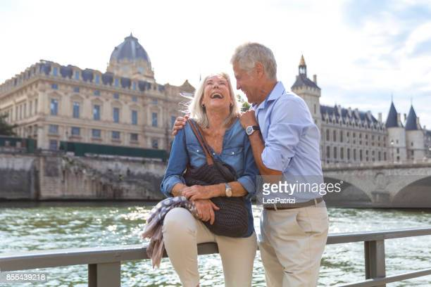 seniors taking a break in paris relaxing on the seine river - europe stock pictures, royalty-free photos & images