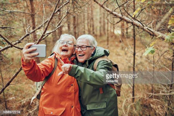 seniors taking a selfie - active seniors stock pictures, royalty-free photos & images