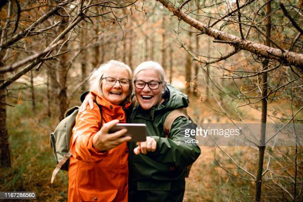 seniors taking a selfie - senior adult stock pictures, royalty-free photos & images